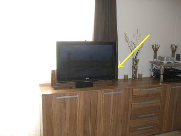 动手把电视做成升降式的,不用时藏柜子里,不占地方也省了背景墙
